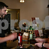 Jeff Engelhardt – jengelhardt@shawmedia.com<br /> Rocko McCombs, right, purchases a bottle of wine from Ben Johnson Friday at the new Prairie on State Wine Cellars in Sycamore.