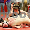 Rob Winner – rwinner@shawmedia.com<br /> <br /> Sycamore's Steven Lalowski (top) controls Morris' Drake Dryfhout during the Northern Illinois Big 12 Conference tournament 145-pound quarterfinals in Ottawa on Saturday.