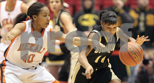 Kyle Bursaw – kbursaw@daily-chronicle.com<br /> <br /> Sycamore's Lake Kwaza steals the ball away from DeKalb's Courtney Patrick. The DeKalb Barbs defeated the Sycamore Spartans 30-21 in their annual game at the Convocation Center on Friday Jan. 28, 2011.