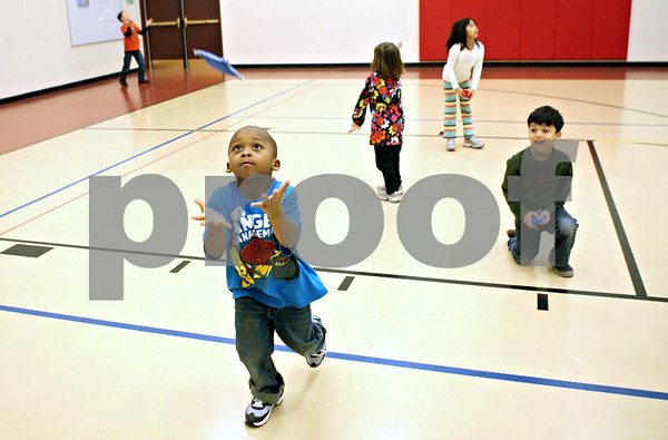 Rob Winner – rwinner@shawmedia.com<br /> <br /> Tyler Curtis, 5, reaches to for a beanbag he tossed into the air during an after-school CATCH Program physical activity at Southeast Elementary School in Sycamore on Tuesday, Jan. 10, 2012. CATCH stands for a Coordinated Approach To Child Health and is a coordinated school health program designed to promote physical activity, healthy food choices and the prevention of tobacco use in children.