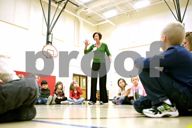 Rob Winner – rwinner@shawmedia.com<br /> <br /> Community health liaison Lisa Cumings, of Kishwaukee Community Hospital gives instructions to a group of Southeast Elementary School students before a physical activity during an after-school CATCH Program on Tuesday, Jan. 10, 2012. CATCH stands for a Coordinated Approach To Child Health and is a coordinated school health program designed to promote physical activity, healthy food choices and the prevention of tobacco use in children.