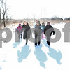 Rob Winner – rwinner@shawmedia.com<br /> <br /> Adventure Works executive director Lynette Spencer (second from left) leads a group of young adults on a hike at Afton Forest Preserve in DeKalb Saturday, Jan. 28. Adventure Works of DeKalb County is a therapy program that assists at-risk youth by participating in outdoor activities.