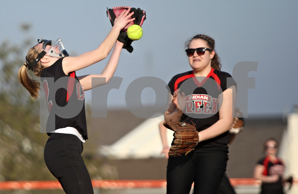 Rob Winner – rwinner@shawmedia.com<br /> <br /> Indian Creek pitcher Amanda Woodbury (left) can not hang on to a pop fly during the bottom of the third inning in Genoa on Wednesday. Genoa-Kingston defeated Indian Creek, 16-0, in five innings.