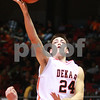 Kyle Bursaw – kbursaw@daily-chronicle.com<br /> <br /> DeKalb's Kyle Berg hits a layup over Sycamore's Brendan Biffany<br /> The DeKalb Barbs defeated the Sycamore Spartans 53-40 during their annual game at the Convocation Center on Friday Jan. 28, 2011.