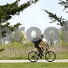 Rob Winner – rwinner@shawmedia.com<br /> <br /> A cyclist cruises along the DeKalb/Sycamore Trail near the DeKalb County Highway Department Saturday afternoon.