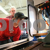 "Kyle Bursaw – kbursaw@shawmedia.com<br /> <br /> Rich Nelson, 21, calibrates a machine in his computer-aided manufacturing class as instructor Bob Lawrence looks on at Kishwaukee College on Wednesday, April 4, 2012. Nelson started learning about manufacturing when he took classes at the college for two years through the Kishwaukee Education Consortium program while a student a Genoa-Kingston High School. ""[The KEC program] got me ready for this, its a perfect start,"" said Nelson who works at Sycamore Precision."