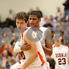 Rob Winner – rwinner@shawmedia.com<br /> <br /> DeKalb's Jake Carpenter (front) is congratulated by Andre Harris after Carpenter controlled an offensive rebound late in the fourth quarter in DeKalb on Friday, Feb. 17, 2012. DeKalb defeated Rochelle, 69-67.