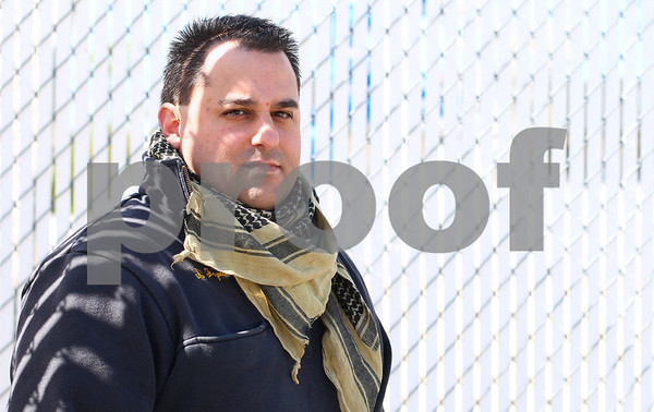 Kyle Bursaw – kbursaw@shawmedia.com<br /> <br /> Scott Joyner, pictured at Hopkins Park on Wednesday, wears a shemagh scarf around his neck, however when he was stationed in Iraq as a contract firefighter with the Department of Defense, he would wear the scarf over his whole head to shield from the blowing sands during his two and a half years there.<br /> <br /> Wednesday, April 11, 2012.