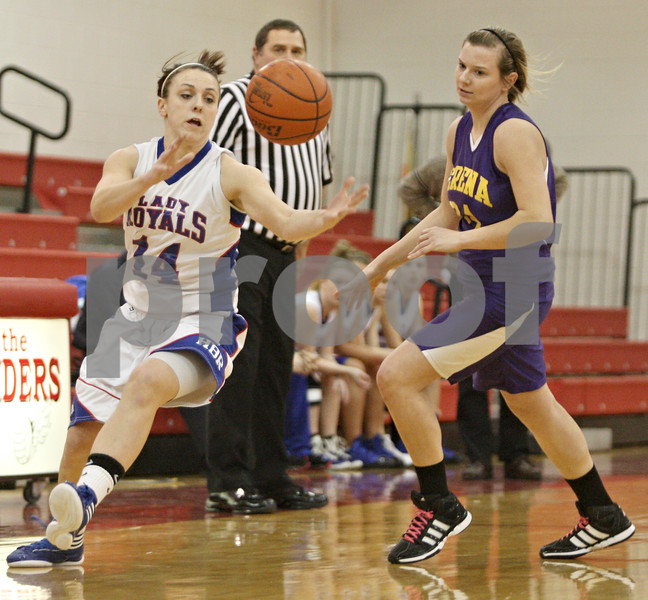 Rob Winner – rwinner@shawmedia.com<br /> <br /> Hinckley-Big Rock's Kaitlin Phillips (14)  steals a ball from Serena's Jeri Brennan (24) in the first quarter during their Little Ten Conference tournament game in Earlville on Thursday.