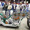 "Kyle Bursaw – kbursaw@shawmedia.com<br /> <br /> People at the Northern Illinois farm show stop to look at the motorcycle the DeKalb corn brand had designed by Paul Jr. Designs of Discovery Channel's ""American Chopper- Senior v. Junior,"" to celebrate the company's 100th anniversary. The bike will be auctioned online starting Jan. 20, 2012, with proceeds going to the American Red Cross."