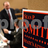 Kyle Bursaw – kbursaw@shawmedia.com<br /> <br /> DeKalb County State's Attorney candidate Sean Smith (seated) shakes hands with Greg Anderson, who moderated the debate between smith and incumbent Clay Campbell at Swen Parson Hall on Tuesday, March 6, 2012