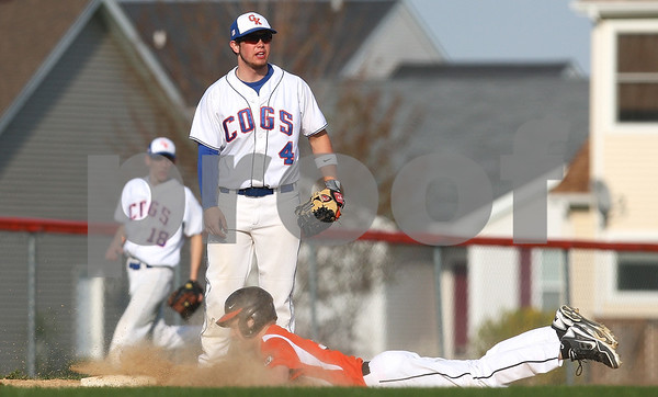 Kyle Bursaw – kbursaw@shawmedia.com<br /> <br /> Winnebago's Tom LaBrecque slides into third as Genoa-Kingston's Mason Lucca is left waiting for the ball in Genoa, Ill. on Monday, April 2, 2012.