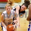 Kyle Bursaw – kbursaw@shawmedia.com<br /> <br /> Indian Creek's Ariel Russell tries to get the ball from Paw Paw guard Shelsie Crawford during the second quarter of the Class 1A Indian Creek Regional Quarterfinal on Monday, Feb. 6, 2012. Indian Creek defeated Paw Paw 51-39.
