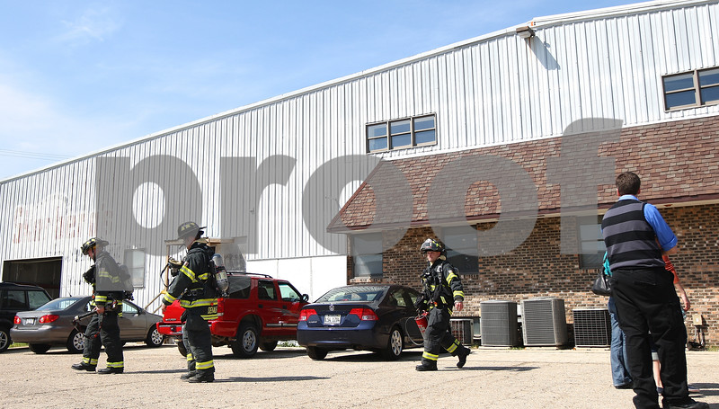 Kyle Bursaw – kbursaw@shawmedia.com<br /> <br /> Firefighters exit the Northern Illinois University Art Annex at 2211 Sycamore Road where there was a furnace malfunction in DeKalb, Ill. on Tuesday, April 3, 2012.