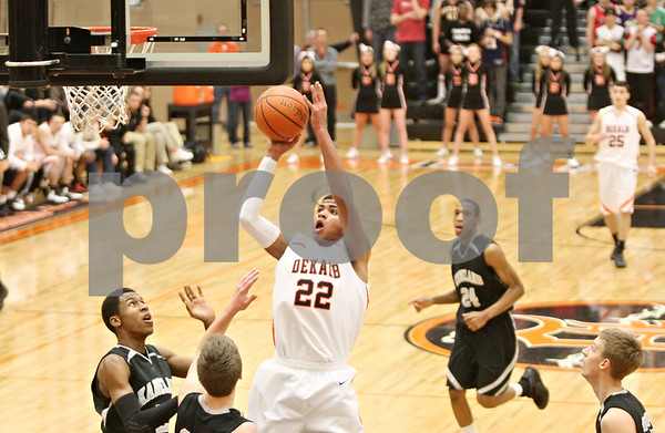 Rob Winner – rwinner@shawmedia.com<br /> <br /> DeKalb's Andre Harris (22) puts up a shot during the first quarter in DeKalb on Friday, Feb. 10, 2012. Kaneland defeated DeKalb, 65-55.