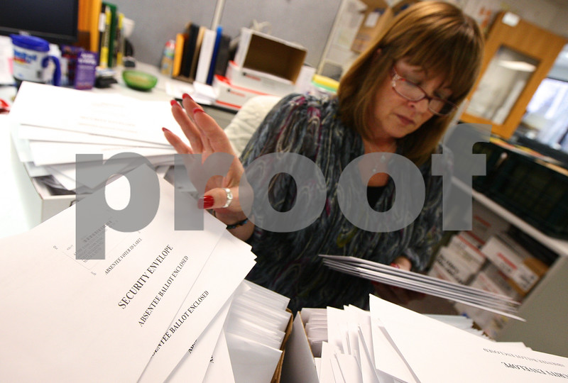 Kyle Bursaw – kbursaw@shawmedia.com<br /> <br /> Deputy Clerk of Elections Lynne Kunde sorts absentee ballots by precinct in the DeKalb County Clerk's office in Sycamore, Ill. on Monday, March 19, 2012.