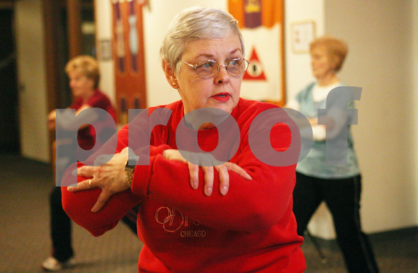 Rob Winner – rwinner@shawmedia.com<br /> <br /> Marjorie Rey watches and follows a workout video during a weekly exercise program at Westminster Presbyterian Church of Dekalb on Tuesday evening.