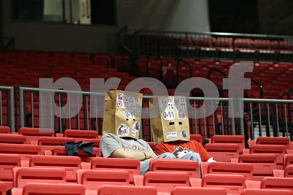 Rob Winner – rwinner@shawmedia.com<br /> <br /> Two Northern Illinois fans wear bags over their heads while watching the Huskies take on Roosevelt in DeKalb, Ill., on Monday, Jan. 2, 2012.