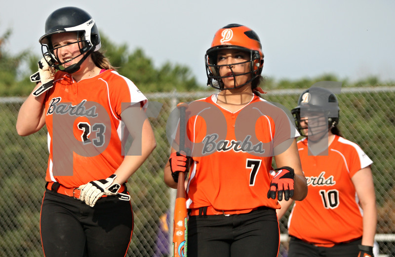 Rob Winner – rwinner@shawmedia.com<br /> <br /> DeKalb base runners Sarah Friedlund (23), Jessica Townsend (7), and Jaycee Reeves (10) head back to the dugout after scoring three runs on three errors committed by Belvidere during the second inning in DeKalb on Friday. DeKalb defeated Belvidere, 5-2.