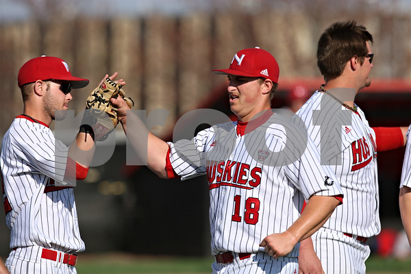 Rob Winner – rwinner@shawmedia.com<br /> <br /> Northern Illinois pitcher Eli Anderson is greeted by his teammates after the top of the fourth inning in DeKalb on Tuesday afternoon.