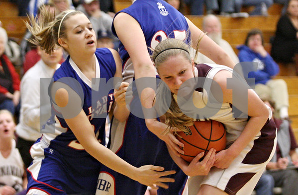 Rob Winner – rwinner@shawmedia.com<br /> <br /> Hinckley-Big Rock's Jacqueline Madden (left) and Annawan's Riley Jackson struggle for possession of a loose ball in the first quarter during the Class 1A Varna Sectional semifinal on Tuesday night.