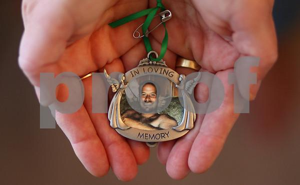 Kyle Bursaw – kbursaw@shawmedia.com<br /> <br /> Sue Olsen holds an ornament with her son Bradley Olsen's photo in it on Tuesday, Jan. 17, 2012. <br /> Bradley Olsen disappeared five years ago on Jan. 20, 2007.