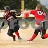 Rob Winner – rwinner@shawmedia.com<br /> <br /> Indian Creek baserunner Emily Bergstrand (left) slides safely into home plate after a passed ball pitched by LaMoille's Tori De Waele (00) during the second inning Friday in Shabbona. Indian Creek defeated LaMoille, 21-7, in five innings.