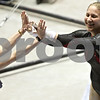 Rob Winner – rwinner@shawmedia.com<br /> <br /> Northern Illinois' Shonda Clore (right) is congratulated by assistant coach Nita Teague after Clore's routine on the uneven parallel bars during the 2012 Mid-American Conference Gymnastics Championships at the Convocation Center in DeKalb on Saturday afternoon.