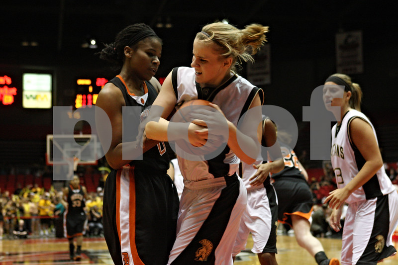Rob Winner – rwinner@shawmedia.com<br /> <br /> DeKalb's Janay Wright (left) and Sycamore's Jessica Mollman struggle for control during the fourth quarter. DeKalb defeated Sycamore, 39-37, on Friday night at the Convocation Center in DeKalb.