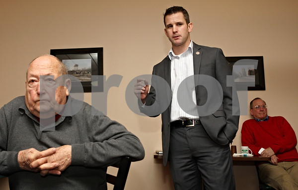 Rob Winner – rwinner@daily-chronicle.com<br /> <br /> DeKalb resident John Dlabal, Jr. (left) listens to Rep. Adam Kinzinger, who is running for the 16th Congressional District,  during a town hall meeting at The Lincoln Inn in DeKalb on Saturday afternoon.