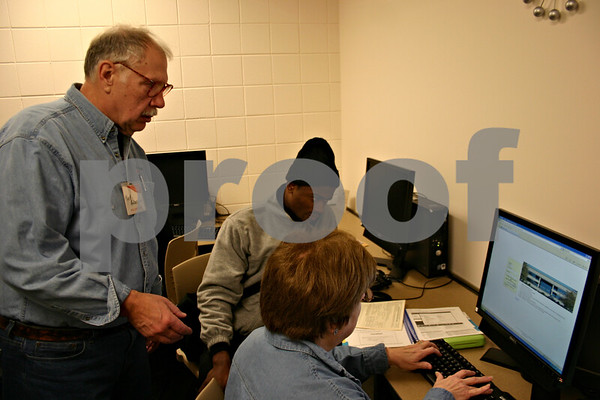 Jeff Engelhardt – jengelhardt@shawmedia.com<br /> Mark Anderson, left, and Kathy Spears help George Madu with his taxes Thursday at the DeKalb County Community Services Building. The county is offering free assistance to senior citizens and low to moderate income families and individuals.