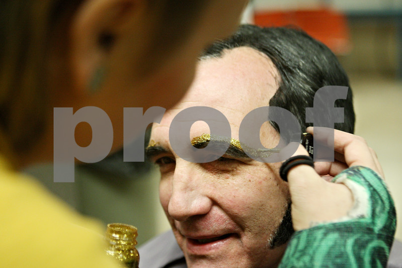 """Rob Winner – rwinner@shawmedia.com<br /> <br /> Danielle Pagoria (left) applies makeup to Andy Small before rehearsal of """"Joseph and the Amazing Technicolor Dreamcoat ,"""" at Northern Illinois University's O'Connell Theatre, Stevens Building on the DeKalb campus on Tuesday night."""