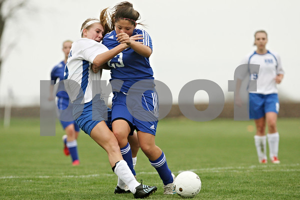 Rob Winner – rwinner@shawmedia.com<br /> <br /> Hinckley-Big Rock's Josie Kossman (left) is taken down by Aurora Central Catholic's Kelly Latkiewicz during the second half in Hinckley on Thursday. H-BR was awarded a penalty kick that Caitlin Phillips (right) scored for the Royals' second goal. H-BR defeated ACC, 2-0.