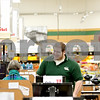Rob Winner – rwinner@shawmedia.com<br /> <br /> Cashier Justin Higgs talks with a customer at Brown's Country Market in Genoa on Thursday afternoon. Brown's is one of several Genoa businesses that has benefited from a tax-break package.<br /> <br /> Thursday, Jan. 19, 2012