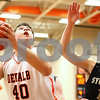 Kyle Bursaw – kbursaw@shawmedia.com<br /> <br /> DeKalb center Jake Smith goes for a shot with Sycamore forward Devin Mottet defending in the second quarter. DeKalb defeated Sycamore 41-36 at DeKalb High School on Friday, Feb. 24, 2012.
