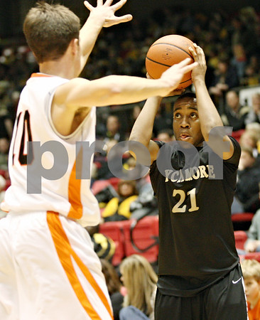 Rob Winner – rwinner@daily-chronicle.com<br /> <br /> DeKalb's Brian Sisler (10) tries to pressure Sycamore's Rashaud Bomar during the fourth quarter of Friday night's game at the Convocation Center in DeKalb, Ill., on Friday, January 28, 2011.