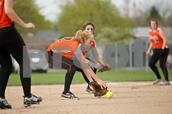 Rob Winner – rwinner@shawmedia.com<br /> <br /> DeKalb pitcher Kaylin Kennedy fields a bunt during the second inning in DeKalb on Friday. DeKalb defeated Belvidere, 5-2.