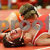 Rob Winner – rwinner@shawmedia.com<br /> <br /> DeKalb's Doug Johnson (top) controls Streator's Erick Gonzales during the Northern Illinois Big 12 Conference tournament 126-pound quarterfinals in Ottawa on Saturday.