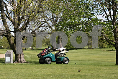 Rob Winner – rwinner@shawmedia.com  Executive Director of Kishwaukee Special Recreation Association Suzie Zeeh takes the new SoloRider golf cart for a spin at River Heights Golf Course in DeKalb Tuesday afternoon. The cart allows users to be able to play golf who may have difficulties walking. The cart will be shared between River Heights and the Sycamore Golf Club.