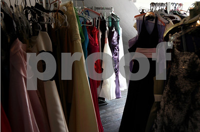Kyle Bursaw – kbursaw@shawmedia.com  Donated dresses wait in the attic of the NIU Women's Resource Center as part of Project Prom on Monday, April 16, 2012, where girls can get a free dress throughout April. The center is open Monday to Friday from 8 a.m. to 4:30 p.m. and no appointment is necessary.