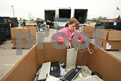 Rob Winner – rwinner@shawmedia.com  Barb Ehresman, CEO of Advanced Technology Recycling, cuts the cord from a keyboard during an electronics recycling collection at the DeKalb County Health Department's parking lot Saturday morning. The event was sponsored by the DeKalb County Solid Waste Management Program and the DeKalb County Farm Bureau.