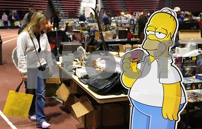 Kyle Bursaw – kbursaw@shawmedia.com  Cindy McKinney looks through items for sale at the Convocation Center's Colossal Clean Sweep indoor garage sale near a cardboard cutout of Homer Simpson on Friday, April 20, 2012.