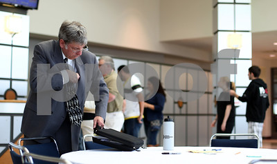 Kyle Bursaw – kbursaw@shawmedia.com  Jobseeker Steve Reinert, of Elgin, gathers his belongings from a table as he prepares to venture into one of the two rooms of potential employers at the annual College Employment and Training Fair at Kishwaukee Community College on Thursday, April 19, 2012.