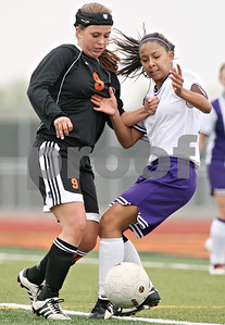 Rob Winner – rwinner@shawmedia.com  DeKalb's Alli Smith (9) and Rochelle's Cynthia Valencia (right) compete for a ball during the first half of their game Saturday at Barbfest in DeKalb. DeKalb defeated Rochelle, 7-0.