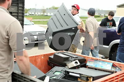Rob Winner – rwinner@shawmedia.com  Justin Leroy of Advanced Technology Recycling carries a television from a vehicle during an electronics recycling collection at the DeKalb County Health Department's parking lot Saturday morning. The event was sponsored by the DeKalb County Solid Waste Management Program and the DeKalb County Farm Bureau.
