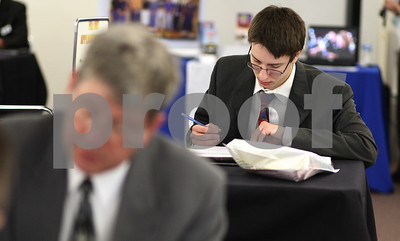 Kyle Bursaw – kbursaw@shawmedia.com  Genoa resident Ryan Hermann, 25, fills out paperwork during the annual College Employment and Training Fair at Kishwaukee Community College on Thursday, April 19, 2012.