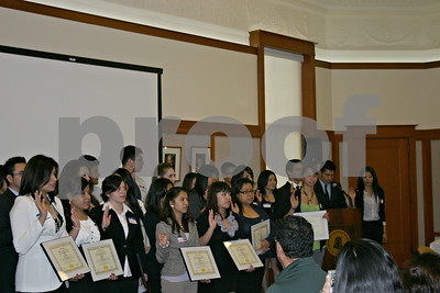 Members of the Adela de le Torre Honor Society, the first Latino honor society at Northern Illinois University, take the oath as they are inducted into the group Sunday at Altgeld Hall.  Caitlin Mullen - cmullen@shawmedia.com