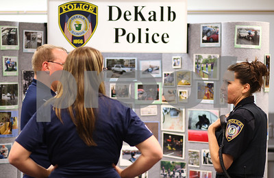 Kyle Bursaw – kbursaw@shawmedia.com  Patrol officer Elizabeth Fabro (right) talks to visitors at the DeKalb Police booth at the annual College Employment and Training Fair at Kishwaukee Community College on Thursday, April 19, 2012.
