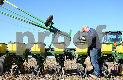 Kyle Bursaw – kbursaw@shawmedia.com  Mike Schweitzer grabs some things out of the toolbox he keeps on his seed planter to make an adjustment while planting in Malta on Thursday, April 12, 2012.