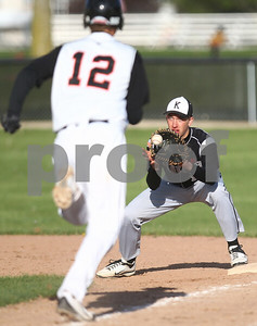Kyle Bursaw – kbursaw@shawmedia.com  Kaneland first baseman Matt Limbrunner makes the out ahead of DeKalb's Matt Hoyle during the bottom of the seventh inning at Huntley Middle School on Monday, April 16, 2012. Kaneland won 6-2.